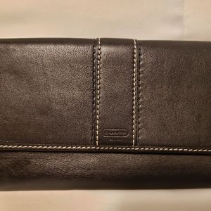 Black leather trifold Coach wallet